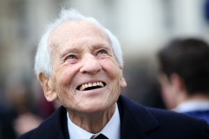 "French Academician Jean d'Ormesson arrives to take part on January 17, 2014 in Paris, in the inauguration of a place in honour of French author Maurice Druon, member of the Academie Francaise and winner of the Prix Goncourt literary prize. Maurice Druon was a French resistant during WWII and one of the authors of the French Resistance song ""Le Chant des Partisans"" (Song of the Partisans). AFP PHOTO/KENZO TRIBOUILLARD"